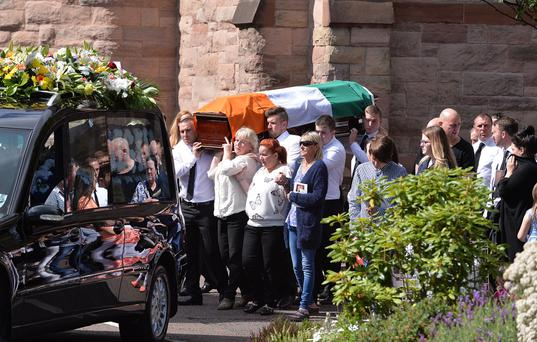 Family and friends of Kevin McGuigan at the funeral of the murdered former IRA man which took place at St Matthew's Church in Belfast yesterday, while the PSNI maintained a heavy presence nearby on the Newtownards Road