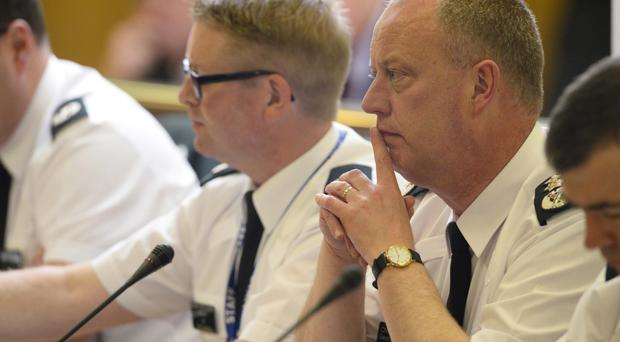 Chief Constable George Hamilton speaks with the Policing Board about the possible involvement of the IRA in the recent murder of Kevin McGuigan in Belfast