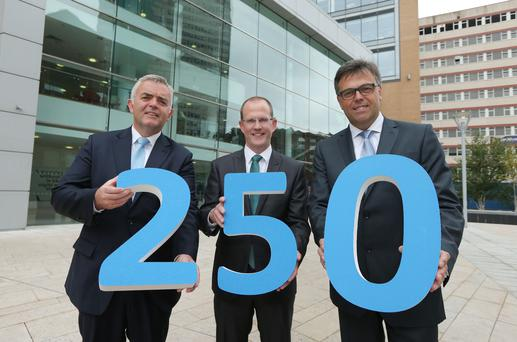 Enterprise Minister Jonathan Bell and Invest NI Chief Executive Alastair Hamilton pictured with IntellingCEO Phil Morgan at today's announcement that the company plans to establish a contact centre in Northern Ireland, creating 250 new jobs. Picture by Kelvin Boyes / Press Eye.