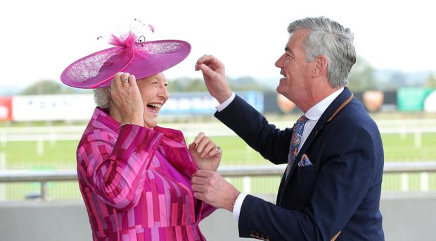 Enjoying the Summer Race Evening at Down Royal Racecourse yesterday were Dame Mary Peters and David Anderson
