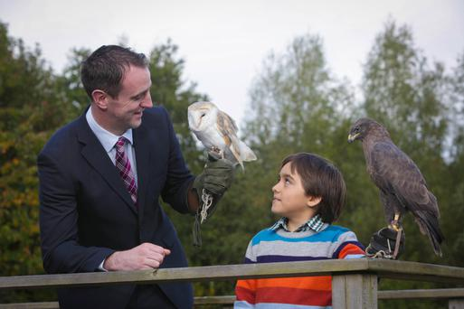 Environment Minister Mark H Durkan and little Luciano Lopes with some feathered friends at the launch of the new campaign