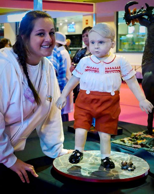 Laura Mason with her Prince George cake