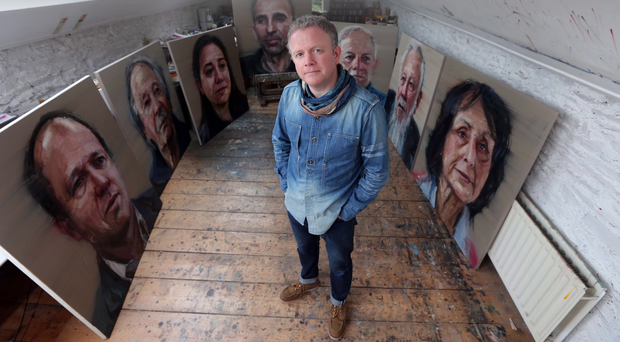 Colin Davidson In his studio with some of his work