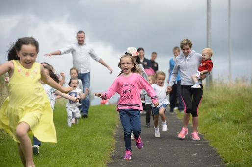 Parents and children celebrate after the Cornfield Project won a £120,000 Grow Wild Award