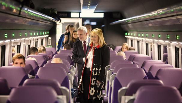 Regional Development Minister Michelle McIlveen and Chris Conway, Group Chief Executive for Translink, on board the first refurbished Enterprise train