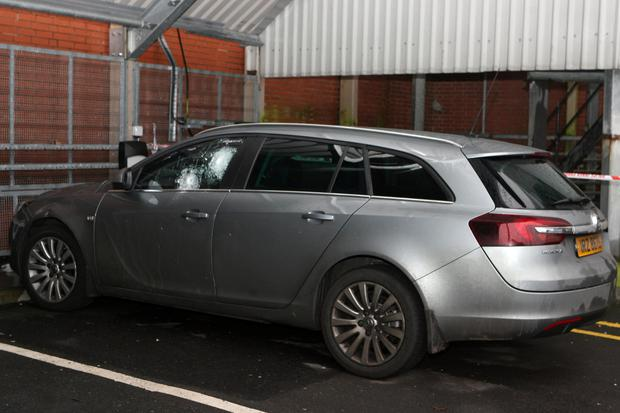The PSNI car which was sprayed with bullets in west Belfast on Thursday night