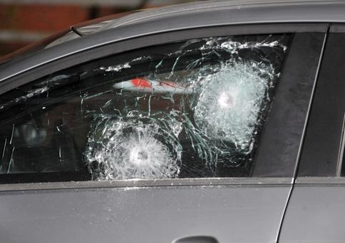 The car's bullet-proof glass helped saved the officers' lives