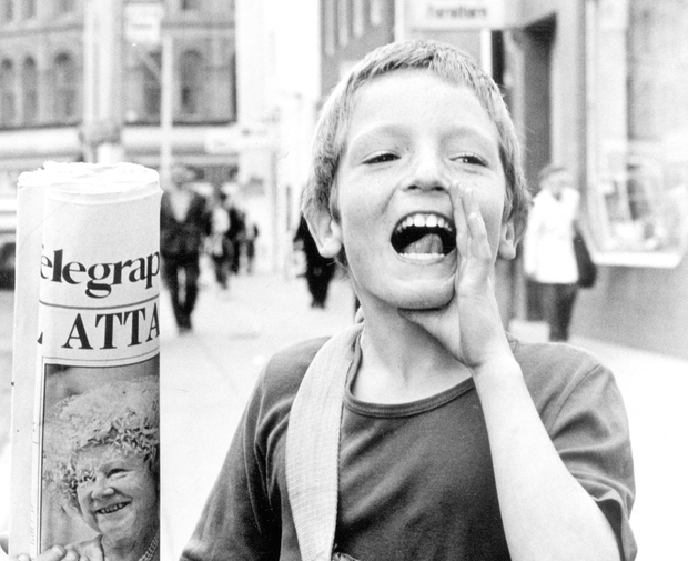 Read all about it: Nine-year-old Emmanuel McGee does his own advertising as he sells the Tele on Royal Avenue in Belfast city centre