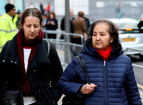 Josephine Herivel (left) and Chandra Balakrishnan, the wife of Aravindan Balakrishnan, leave Southwark Crown Court in London, where he was found guilty of a string of sex assaults, cruelty to a child and false imprisonment
