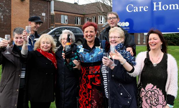 Relatives of Oakridge residents celebrate after hearing that the care home will not close