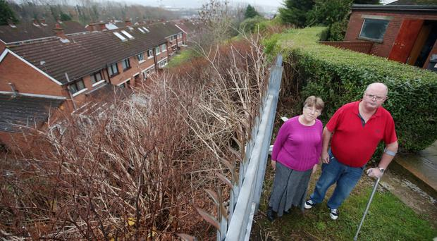 Liz and Adrian Atkinson at their home which is being overrun by Japanese Knotweed from neighbouring wasteland