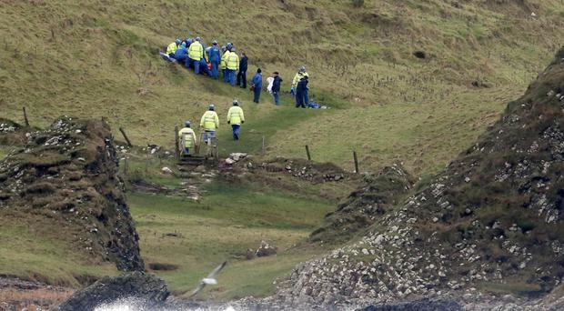 Rescuers attend to injured man on Causeway Coast Way