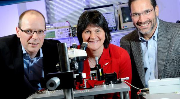 Enterprise Minister Arlene Foster with Dr Andrew Patterson, engineering manager and general manager of M/A-COM Tech UK Ltd, and Mike Murphy, vice president of engineering of M/A-COM Tech UK Ltd at the announcement