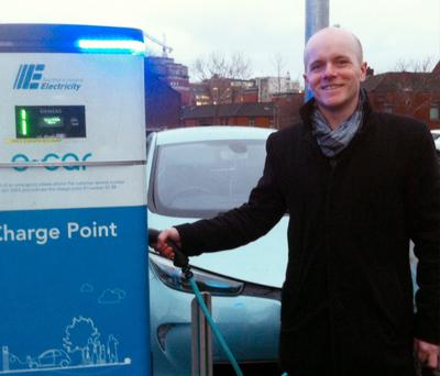 Green Party councillor Ross Brown at a charge point