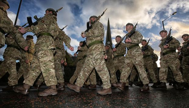 Soldiers from the North Irish Horse Squadron and their Scottish regimental colleagues parade through Carrickfergus