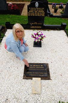 Kathleen Arkinson at a memorial stone to her sister Arlene