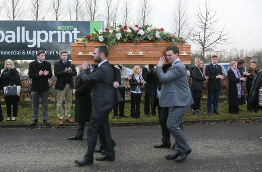 Kieran Bowes' twin brother Curtis (rear) carries his coffin at the funeral