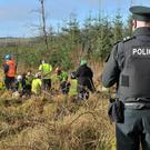 Police keep a watchful eye as protesters confront workers at Woodburn Forest near Carrickfergus yesterday