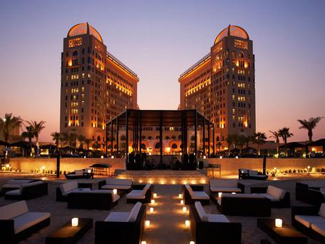 The extravagant St Regis Doha hotel, replete with views over the Persian Gulf