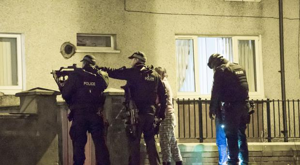 Scenes from the dramatic swoop by heavily-armed police on a house in Aspen Walk in Belfast in the early hours.