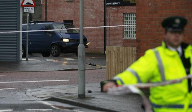 Police seal off the area around Hillsborough Drive in east Belfast after a bomb exploded under a van