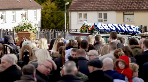 Friends and family at the funeral of Stephen Carson in west Belfast