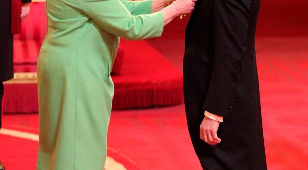 Actor James Nesbitt is made an OBE (Officer of the Order of the British Empire) by Queen Elizabeth at Buckingham Palace