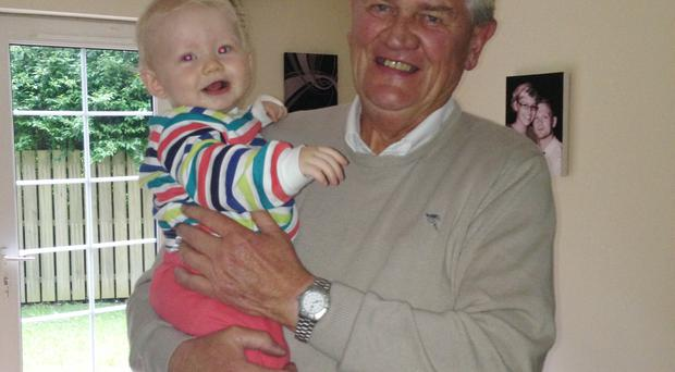 John Niall Greenan with one of his grandchildren