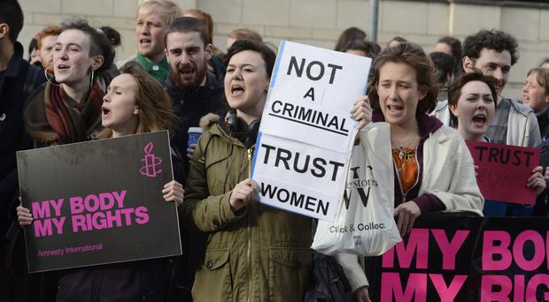 Protesters outside the High Court in Belfast yesterday