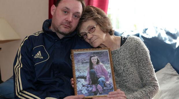 Gina Murray and her son Gary Murray clutch a treasured photograph of Leanne, who was killed in the 1993 bombing of Frizzell's