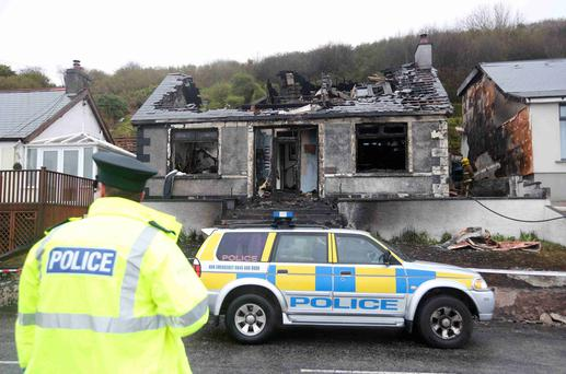 The scene on the Coast Road in Larne where an overnight fire gutted a house