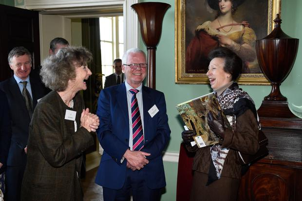 Patrick Cregg and Lady Dufferin present the Princess Royal with a book yesterday