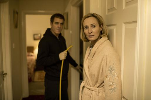 Jimmy Nesbitt as dentist Colin Howell and Genevieve O'Reilly as Hazel Stewart carrying out the double murder