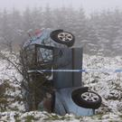 A car that overturned near Belfast in treacherous conditions