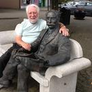 Sam McCready with the Percy French bench in the main square of Ballyjamesduff