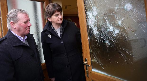 First Minister Arlene Foster surveys the damage at the hall in February with the Orange Order's William Ross