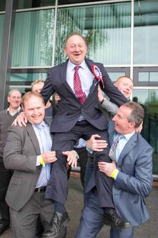 William Irwin, who topped the poll in Newry and Armagh, celebrates with Gareth Wilson and his campaign manager Lavelle McIlwrath