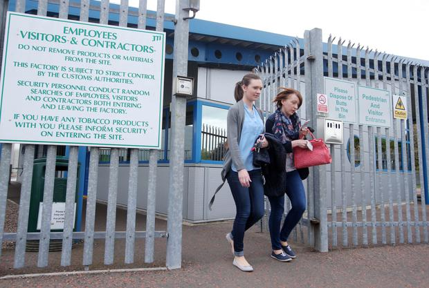 Workers exit the JTI tobacco factory in Ballymena for the last time