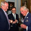 The Prince of Wales shares a joke with guests at Hillsborough Castle
