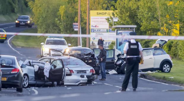Police attend the six-car pile-up yesterday. Photo by Kevin Scott/Presseye