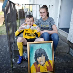 Blake Lowden and his mother Carrieann with some of his George Best memorabilia