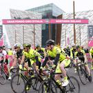 Cyclists pass the Titanic Building at the start of the Gran Fondo Giro d'Italia yesterday