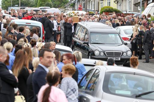 The street is packed with family, friends and nursing colleagues for the funeral of 25-year-old Vikki McKeown