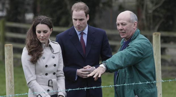 Crosby Cleland shows the Duke and Duchess of Cambridge around his farm