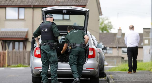 Police officers at the scene of the sudden death of Paul Bloomer in the Hill Street area of Lisburn on Tuesday