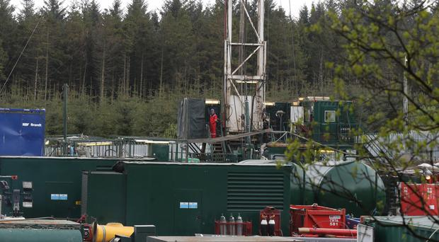 The controversial oil drilling operation at Woodburn Forest near Carrickfergus has been ended, the company says