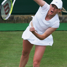 Sporting ace: Claire Curran serves during the ladies doubles match against Venus Williams and Serena Williams during Wimbledon in 2007