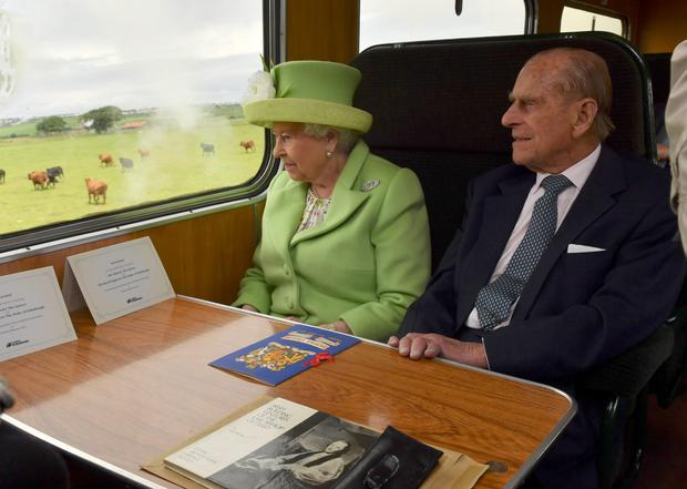 The royals enjoy the view on board the steam train from Coleraine to Bellarena