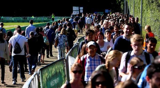 People queue to get into Wimbledon yesterday