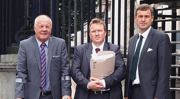 From left: Raymond McCord, solicitor Ciaran O'Hare and Mark Daly